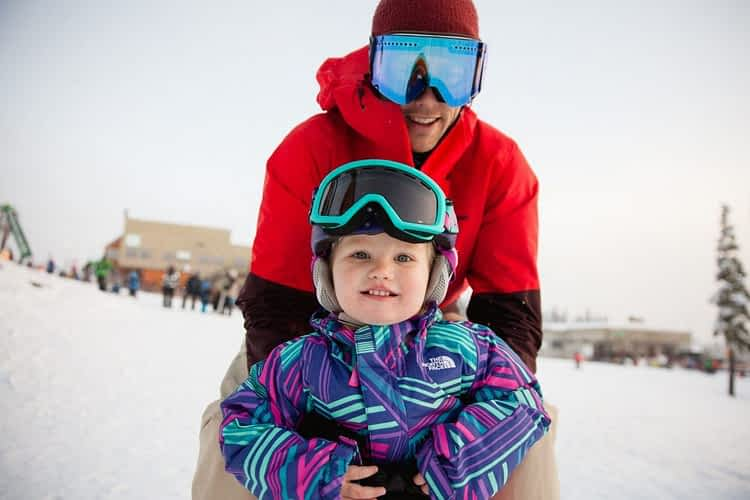 Playing and learning how to ski on the Mount Washington bunny hill ski school